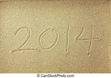 new year message on the sand beach