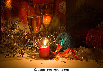 Two glasses of champagne lightening with candle in new year stuff