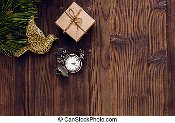new year on wooden background with watch top view