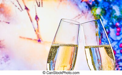 New Year or Christmas at midnight with champagne flutes make cheers on clock and blur background