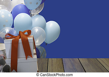 New Year or Valentine day with gift box and colorful ballon on blue background.