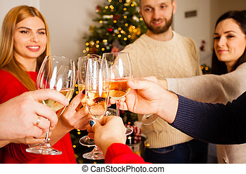 New year party at home with cheering friends
