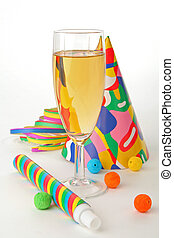 champagne and party with paper ribbon, confetti, ball blowers and party hats