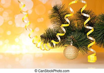New-year pine branch, decorated with serpentine and ball