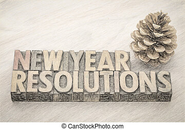 New Year resolutions word abstract in wood type