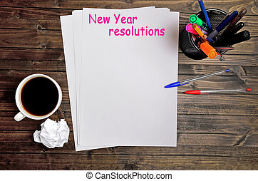 New year resolutions words on paper