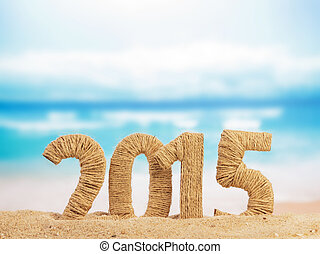 New year sign 2015 on sand