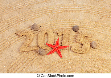 New year sign sand