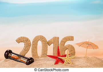 New year sign with starfishes and hourglass on sandy beach