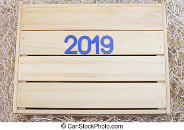New Year. Symbol with on a wooden background