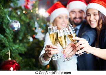 New Year toast - Three business partners toasting with...