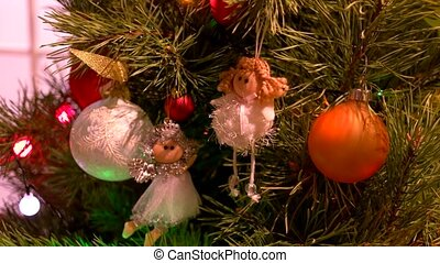 New Year tree decorated with toys close up. White angels and...