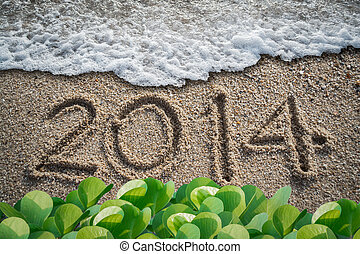 new year with 2014 writen on the beach
