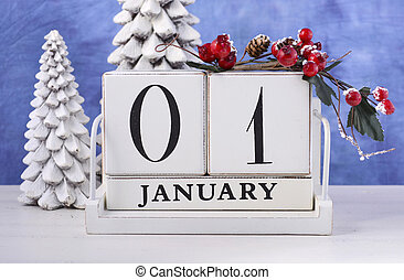 Happy New Year vintage wood block calendar for January 1, with white tree candles against a blue and white background.