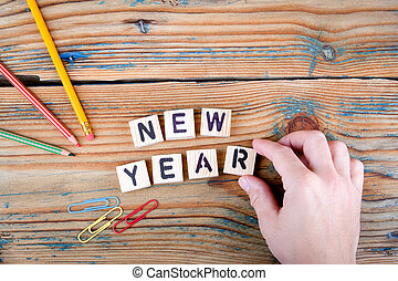 New Year. Wooden letters on the office desk