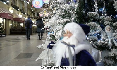 New Year's and Christmas tree decoration with Santa Claus in shopping mall