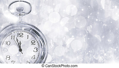 New Year's at midnight - Old clock with stars snowflakes and holiday lights