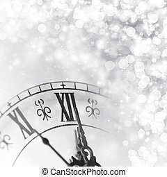 New Year's at midnight  - Old clock against holiday lights