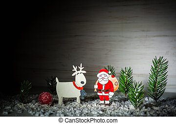 New Year's background. Figures of Santa Claus, deer and boy....