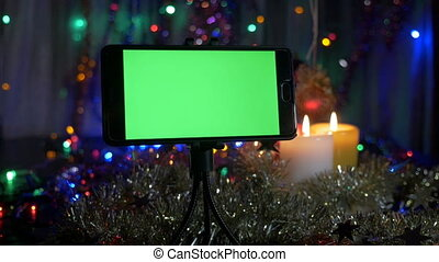 new years background in the foreground a smartphone with a green screen a great