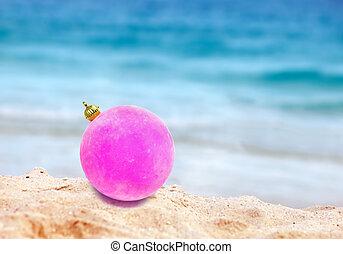 New Year's ball on a beach near the sea