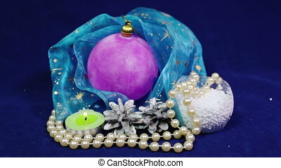 New Year's balls and tinsel on a blue background,