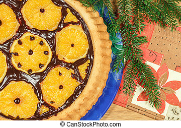 New Year's cake with oranges and fir branch