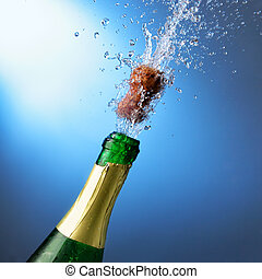 New Year's Champagne - Bottle of champagne with splashes...