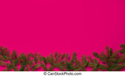 New Year's composition. Spruce branches on a pink background.