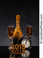 New Year's Eve celebration background with pair glass of...