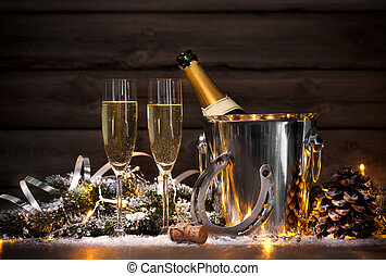 New Years Eve celebration background with pair of flutes and...
