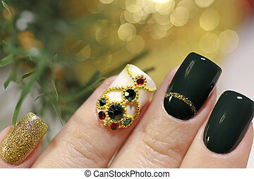 New year's fashionable beautiful festive manicure on short square nails with green lacquer color