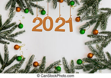 new year's Flatley layout with numbers 2021 in the center with balloons and Christmas tree branches