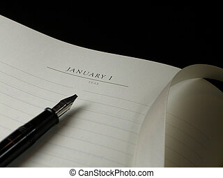 A blank sheet of paper with lines, a silk ribbon bookmark and a black pen against a black background