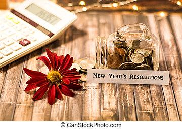 New Year's Resolution money jar savings motivational concept
