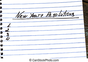New Year's Resolution written on a notepad close-up. New Year resolutions concept