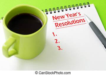 New year's resolutions concept - Pen and notepad with a cup...