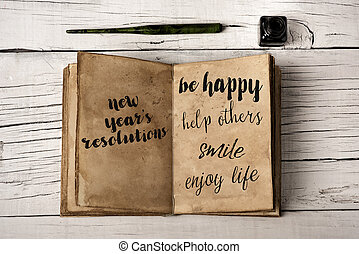new years resolutions in a yellowish notebook