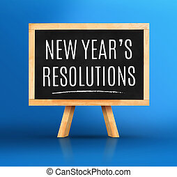 New year's resolutions word on Blackboard with easel on vivid blue studio backdrop, New year planning