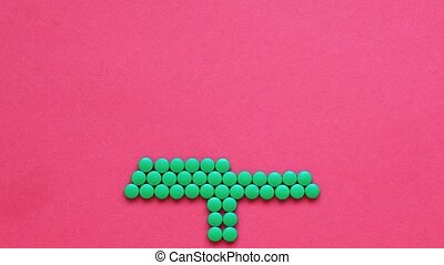 Animation of the movement of a Christmas tree made of green pills on a red