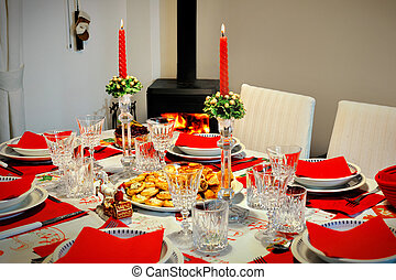 New Year's table in a room with fireplace