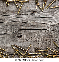 yellow screws on the wooden table - new yellow screws on the...