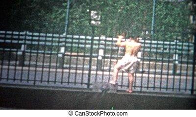 NEW YORK CITY - 1953: Kids playing in pool - Original...