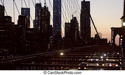Aerial view over manhattan with brooklyn bridge blurred lights night view skyline, abstract background