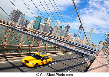 New York City and taxi cab - Taxi cab crossing the Brooklyn...