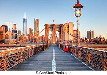 New York City Brooklyn Bridge in Manhattan closeup with skyscrapers and city skyline over Hudson River.