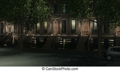 New York City brownstone homes at night 4K - Zoom in...