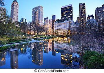 New York City Central Park Lake - Central Park South skyline...