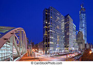 New York City, USA financial district cityscape at night including landmark office buildings.