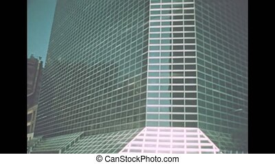 Archival of New York of old glass skyscraper in New York city. United States of America in 1976. Vintage footage in 1970s.